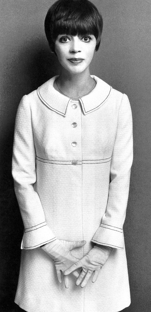 Fashion designer Jean Muir wearing her own design. British fashion designer, though she herself preferred to be called a dressmaker.