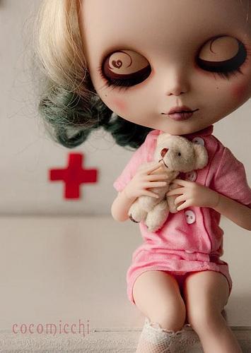 Blythe holding her teddy.