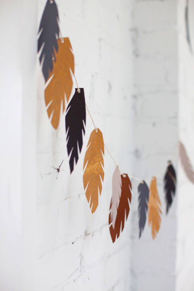 Cut out feathers from paper to make this fall garland.