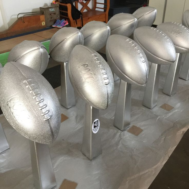 My centerpieces are done for the Woodridge Football Fundraiser!  Dollar Tree bud vases filled with sand, cement glued to foam football (with a little carving out) and spray painted silver. Great Vince Lombardi replica for $2 each!