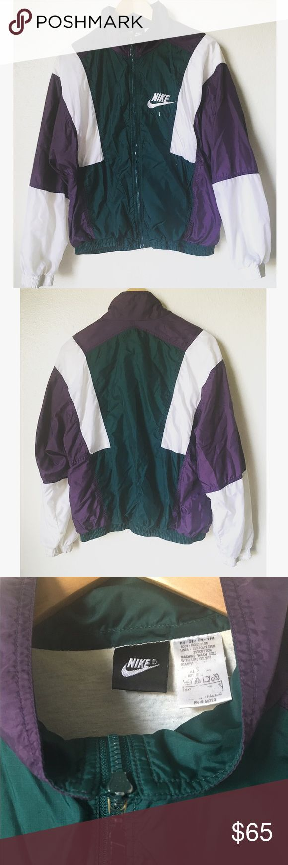 Vintage Nike Zip Up Windbreaker Vintage Nike wind jacket zip up. Colorful and retro! Fits like a medium. Note this is a vintage item and there is some discoloration on the inner and bottoms of the white sleeves. 90s/80s colorblock style. Green white and purple... it's amazing! Nike Jackets & Coats