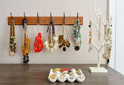 great jewelry storage ideas: hook rail for chunky necklaces and a ceramic egg holder for earrings and rings.
