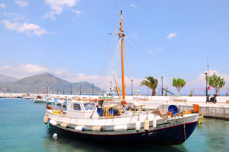 A small boat in the port of Tyros Peloponnese Greece. One of the best places to stay during summer if you wish for peaceful vacations.