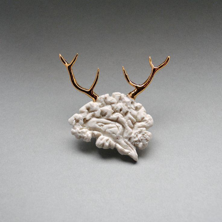 Handmade Porcelain Braindeer brooch with gold lustre antlers made by Jemma Millen Ceramics