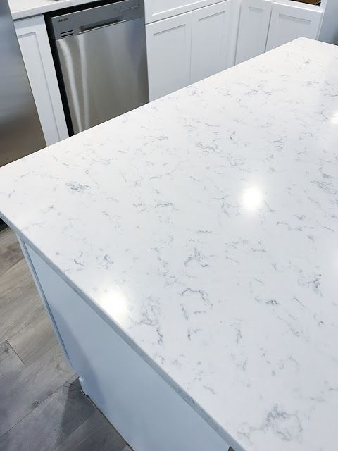 Silestone lyra white marble quartz countertop dani rose for Silestone vs granite