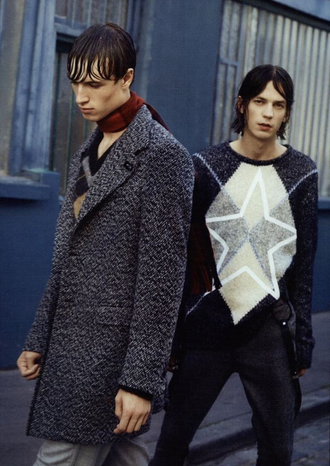 Artful contrasts of light and shade surface from the texture of this salt and pepper coat immortalized by GQ Italia.