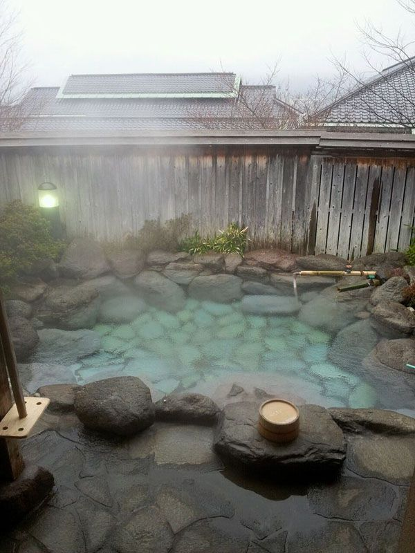 This hot tub with steam coming from the hot water is very appealing to spent some time in!