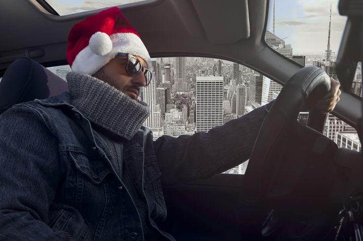 young Santa Claus drives a car. happy christmas!