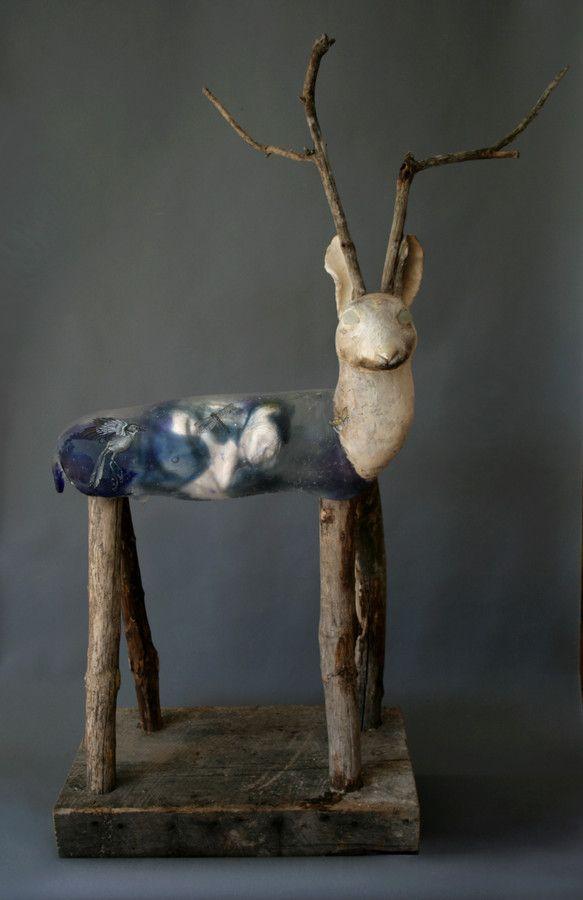 Jackalope,  cast glass, pit fired raku clay, oil paints       Christina Bothwell