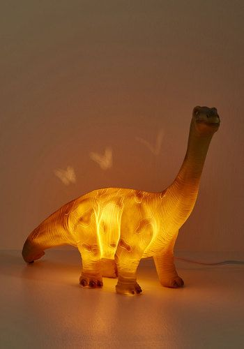 This plastic LED lamp is so stylish, you'll be left in awe of its cretaceous charms! This grey and green dino makes the perfect prehistoric pal to your quirky decor, and when this terrific sauropod begins to glow, you'll 'saur' home just to be by its side!