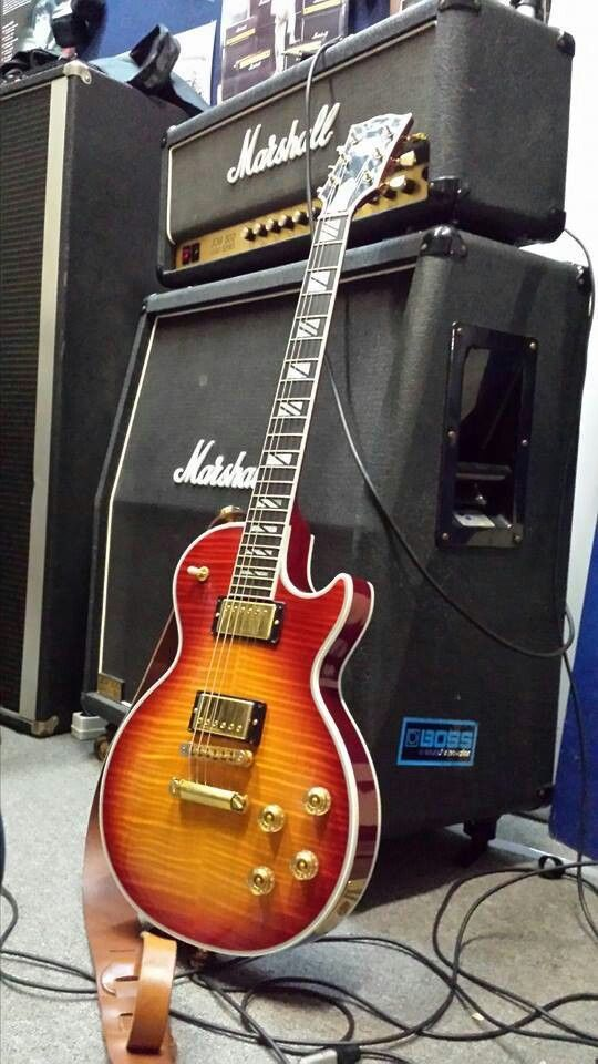 Gibson Les Paul and Marshall JCM 800 half stack.