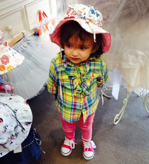 Very Cute Lucia trying on Colourful Toshi Hats!