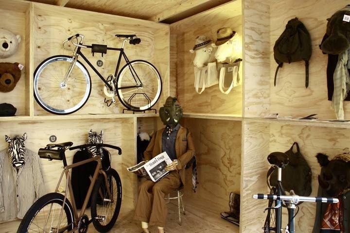 Wood displays, simple, installation style displays (minus creepy guy)