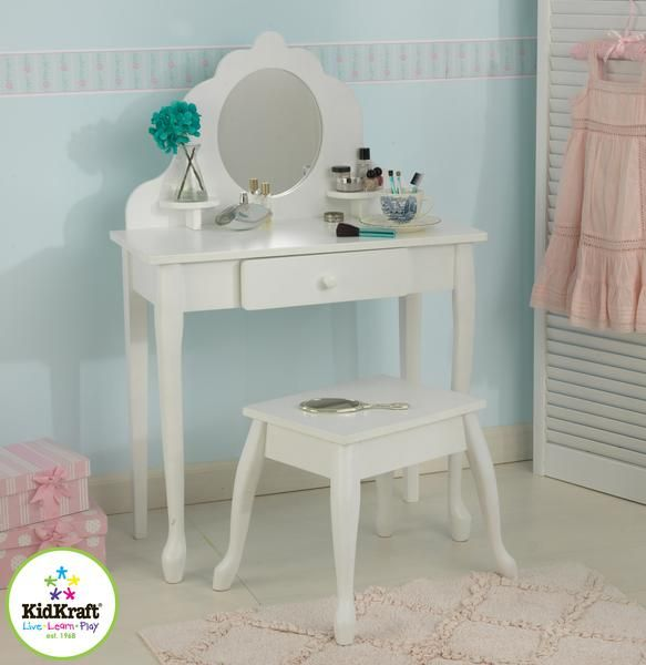 Every little girl needs a vanity table to keep jewelry, brushes and barrettes. KidKraft's white Medium Diva Table and Stool Set is crafted from wood, and is a s