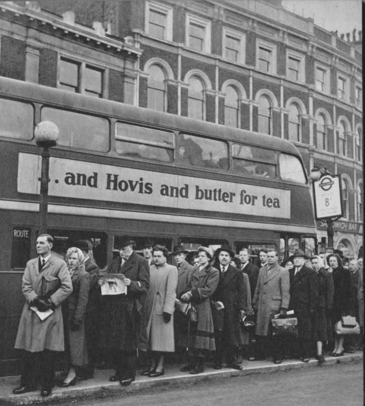 An orderly queue for the number 8 bus at London Bridge Station. | London in 1953 by Cas Oorthuys