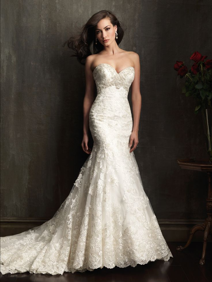 Allure Bridals 9051: A gorgeous fit and flare gown. The fitted bodice has a sweetheart neckline that is embellished with Swarovski crystals. The entire design is adorned with delicate lace appliqué on English net.