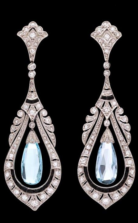 Art Deco Aquamarine and Sapphire Dangle Earrings  Item No. 51317 Platinum Art Deco Earrings feature 2 Briolette Aquamarines Enhanced with 110 Round Cut Diamonds for approximately 1.0 carat along with 24 Dark Blue Faceted Sapphires. Earrings measure 54mm in length x 16mm width and weigh 12.9 grams.
