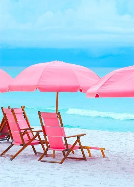 Pink beach chairs and umbrellas