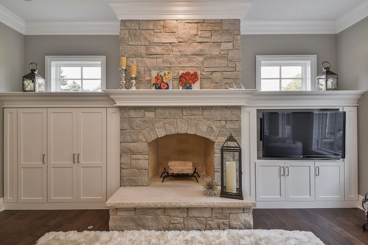 Fireplace with built ins and windows.   Hellyer Custom Builders new construction home in Naperville