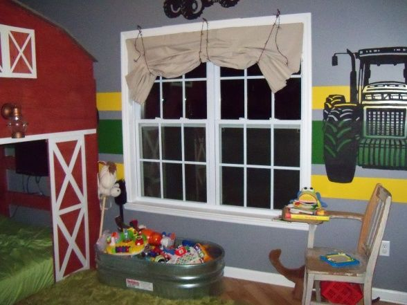 Barn bed with tractor murals. Faux fur rug and trough toy chest.