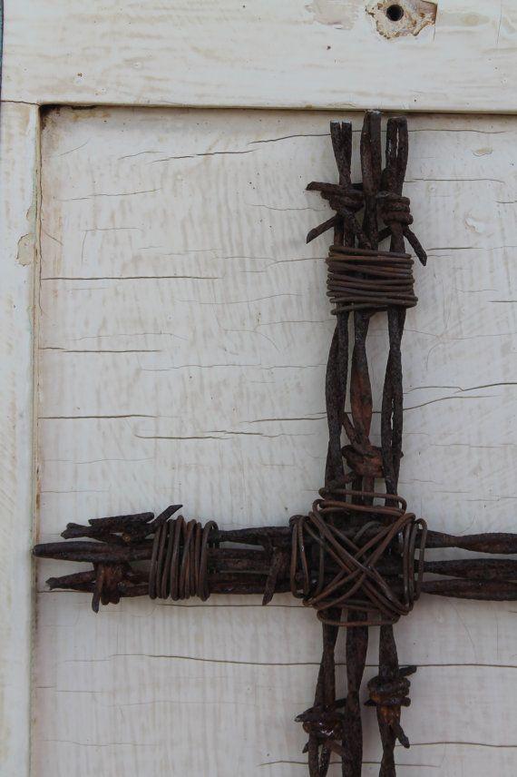 handmade barbed wire cross on door hanging wall by jackrabbitflats