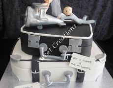 Suitcase wedding cake with Plane cake topper