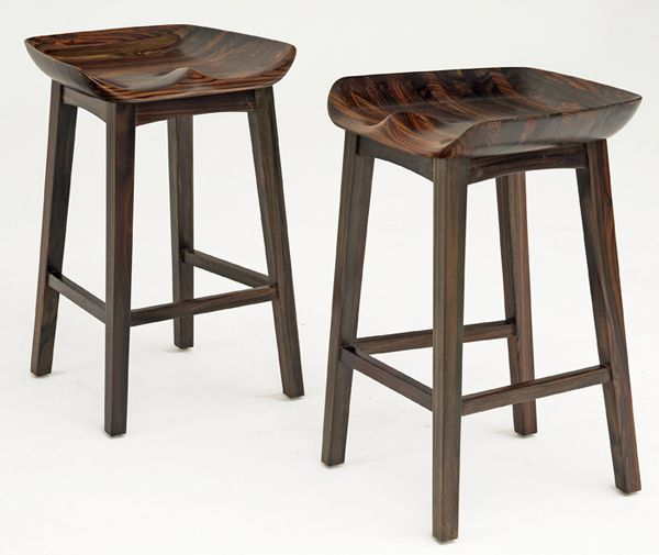 These solid wood bucket seat bar stools combine the amazing comfort of a scooped farm tractor's seat with the linear lines of modern furniture design.  The wood is beautiful solid rosewood.  Rosewood has a natural deep burgundy color with the occasional subtle streaks of red & green running through it.  Mother Nature's artwork will reflect