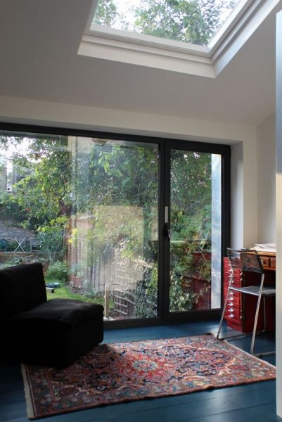 Milton - new study with fully glazed view overlooking new concrete steps up to garden.