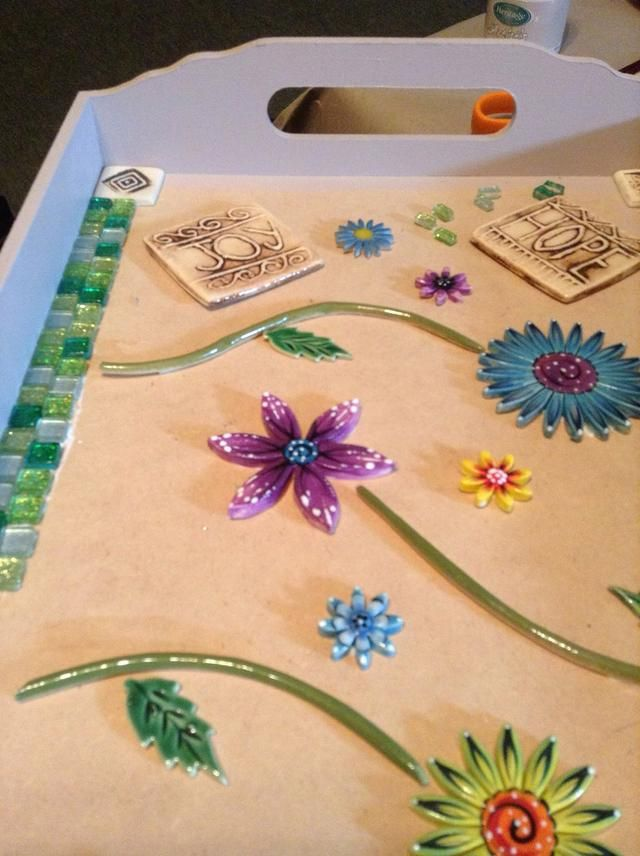 To match the inserts I have selected mosaic tiles with colours that work together. There are no rules - just have fun  Glue each piece as you go along, spread  a little glue on tray and place tile.