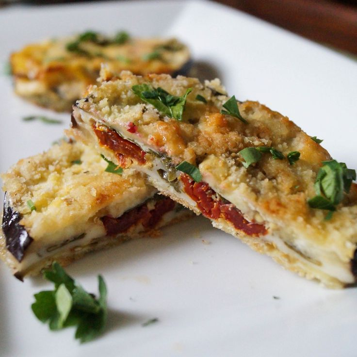 Baked Eggplant Sandwiches:   Ingredients: Eggplant; sliced cheese; sun dried tomatoes; fresh parsley; almond meal; Parmesan cheese; egg.   Slice eggplant 1/4 inch thick circles .  Set oven to 375 F.  Grease baking sheet. On half of the eggplant slices, place a slice of cheese, some sun dried tomato, and parsley. Top with 2nd eggplant slices. Firmly hold the eggplant sandwich and coat in the egg, then coat in the almond meal -parmesan mix. Place on baking sheet, bake 40 minutes until golden.