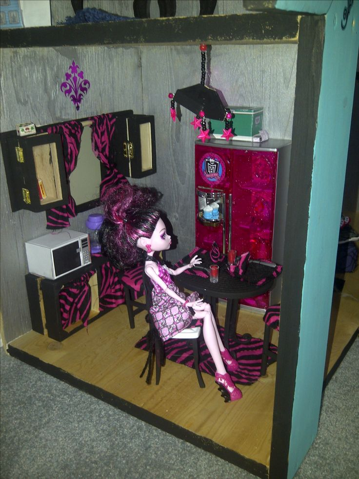 Painted Barbie furniture, and some dollar store wooden candle holders and jewellery boxes converted into doll cupboards.  Fabric from Walmart into chair cushions, placemats, napkins and curtains