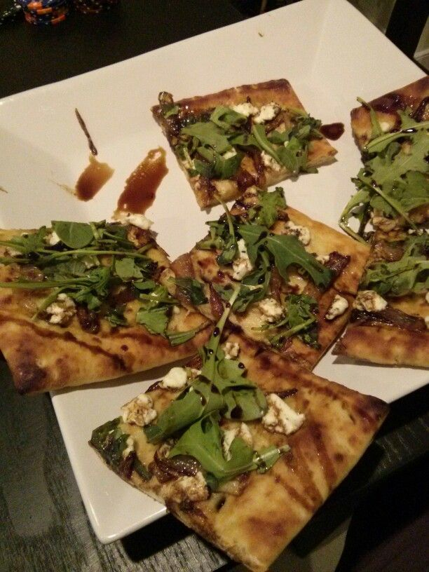 Flatbread appie with caramelized onions,  goat cheese, arugula and balsamic glaze