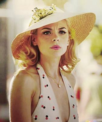 Lemon Breeland wearing a fashionable hat
