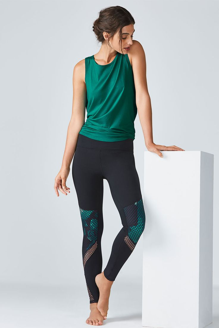 Perfect your coordination in a soft, low-back tank, paired with our mesh-paneled, performance leggings featuring a hint of print.