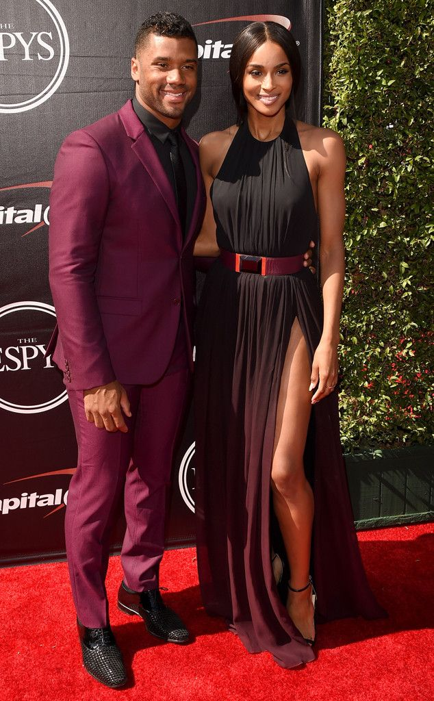Russell Wilson & Ciara from 2015 ESPY Awards Red Carpet Arrivals  Hot couple alert! The duo are ultra-fierce, with Russell styling a merlot-hued tux and Ciara killing it in a draped Elie Saab gown.