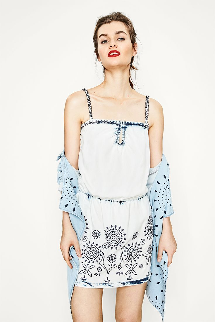 Denim dress with tie-dye and embroidered details A must-have for this spring/summer!