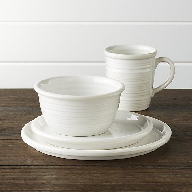 Shop Farmhouse White Dinner Plate.  Ribbed and glazed creamy white, the Farmhouse dinner plate has the casual appeal of hand-thrown pottery.