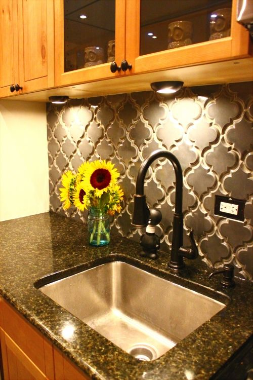 "Love the tiled back splash, so much more interesting than squaree or metro. ""Beveled Arabesque Ceramic tile in ""Up in Smoke"" from Mission Stone & Tile"""