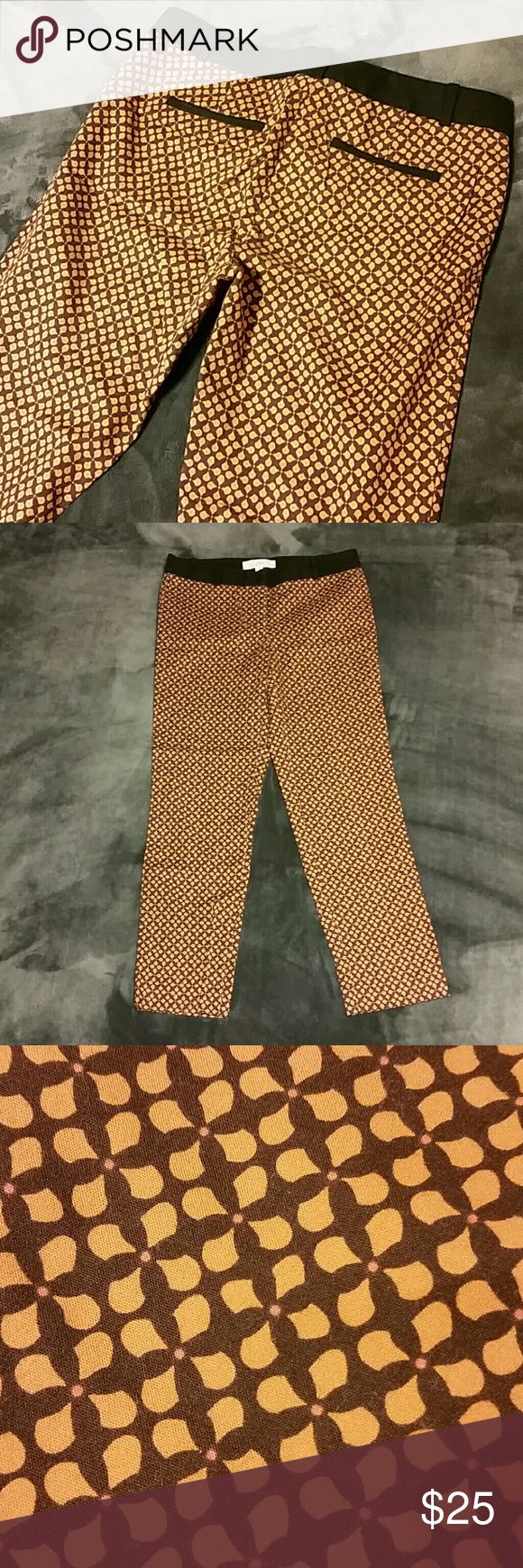 """Anne Taylor Loft retro inspired ankle pants Beautifully patterned retro inspired Anne Taylor Loft pants in excellent, like new condition. Black waistband with brown, muted yellow orange, and peach pattern. Great fall colors! 97%cotton, 3%spandex. Waist 16"""", inseam 26.5. I'm 5'2 and the length reaches just below my ankle. Offers welcome! LOFT Pants Ankle & Cropped"""
