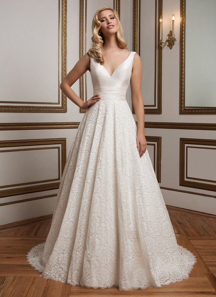 Silk Dupion V-neckline ball gown with a fitted bodice, pleated cummerbund and finished hem lace that create an ambiance of 1950's glamour. https://www.justinalexanderbridal.com/wedding_dresses/8824