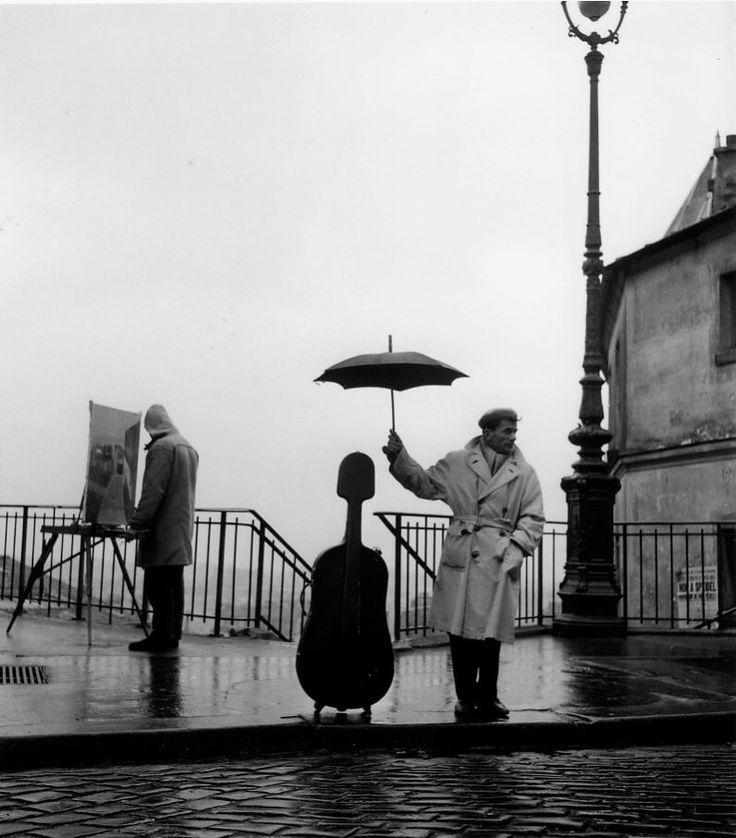 Robert Doisneau - Le violoncelle sous la pluie, Paris 1957