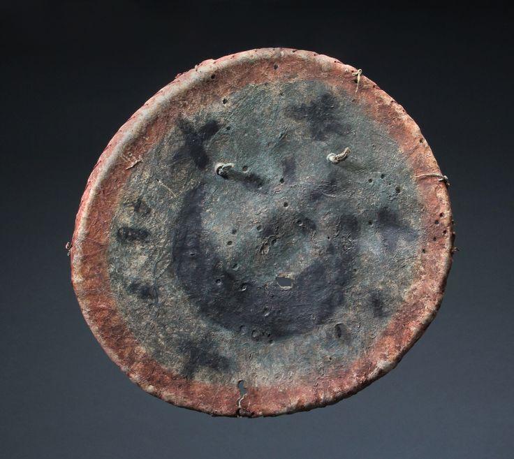 "Kiowa-Comanche Shield, c. 1860.  A very early Kiowa Comanche Shield on buffalo hide.Worn on the back of a warrior as protective medicine. 15"" wide. Sherwoods Spirit of America."