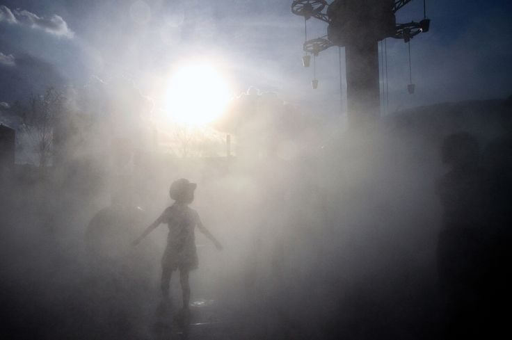 Urban population mist Girl in the fog