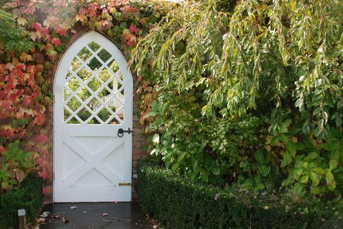 Create your own fall wonderland by incorporating a growing vine into a garden gate scene. These leaves on this particular vine are perfect for the fall season and it may even be the kind of vine that naturally changes colors. Adding plants to the landscape can definitely help bring in any season, but especially fall since so many plants do change colors to ring in the season. This is a simple yet elegant way to work with what you've got.