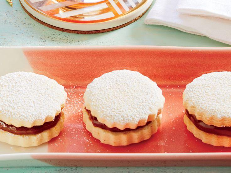 Prepared dulce de leche is spooned between these traditional Latin American cornstarch cookies.