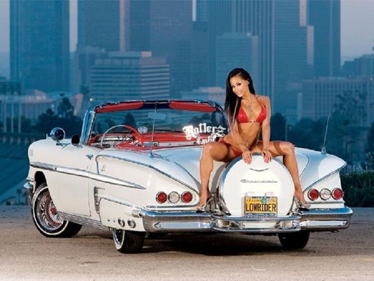 1958 Chevrolet White Impala Convertible with optional passenger on the continental kit.