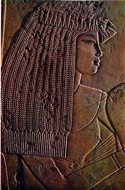 Lady in Waiting: detail of a limestone relief representing a festive gathering, in the tomb of the vizier Ramose at Thebes, New Kingdom, XVIIIth Dynasty, approx. 1400-1362 BCE http://www.pinterest.com/stpaulshigh/egyptian-art/