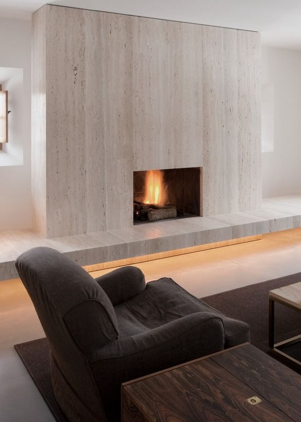 Travertine fireplace, by John Pawson. Warm White Strip Lights by Lumilum - minimalistic!