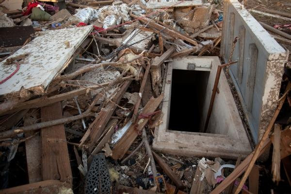 FEMA Moore, Okla., May 22, 2013 -- A storm shelter used during the recent tornado in Moore, Oklahoma. The shelter door was minimally damaged and all in...