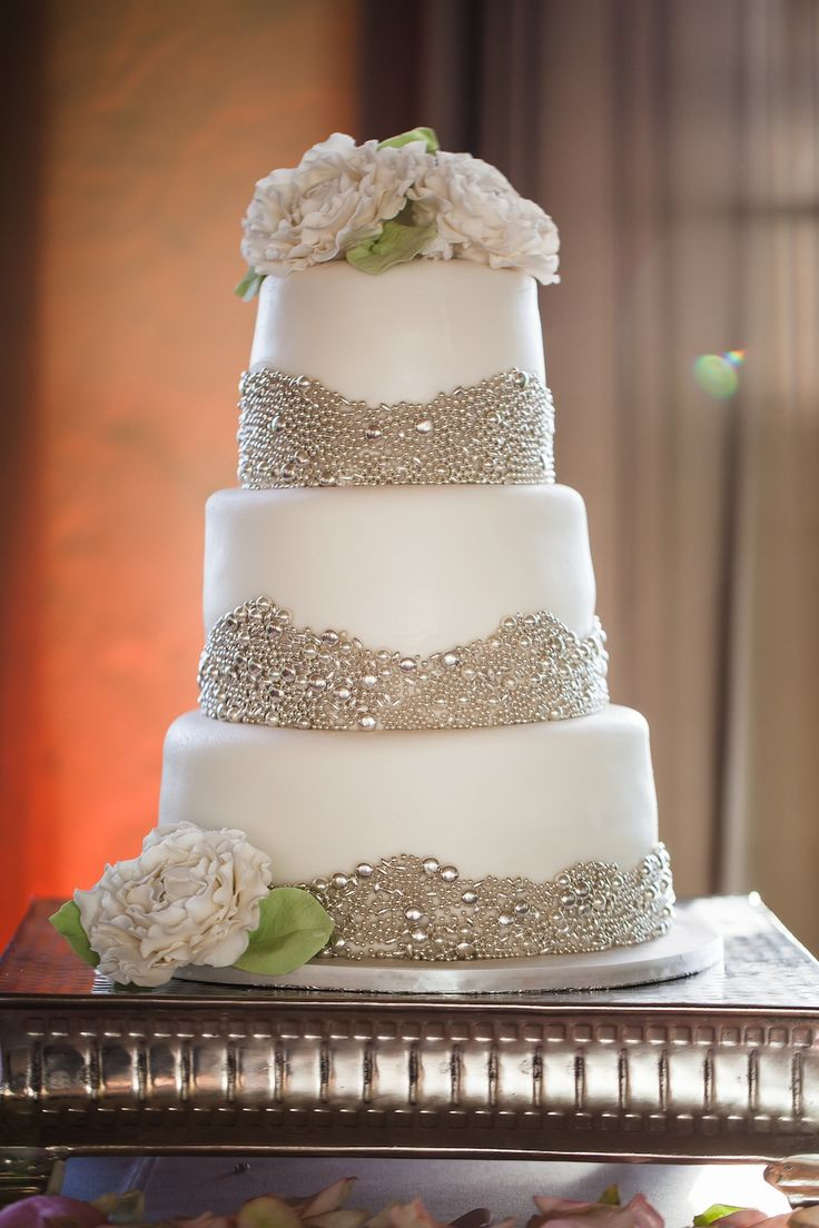 Amazing pearl and silver embellished beach wedding cake